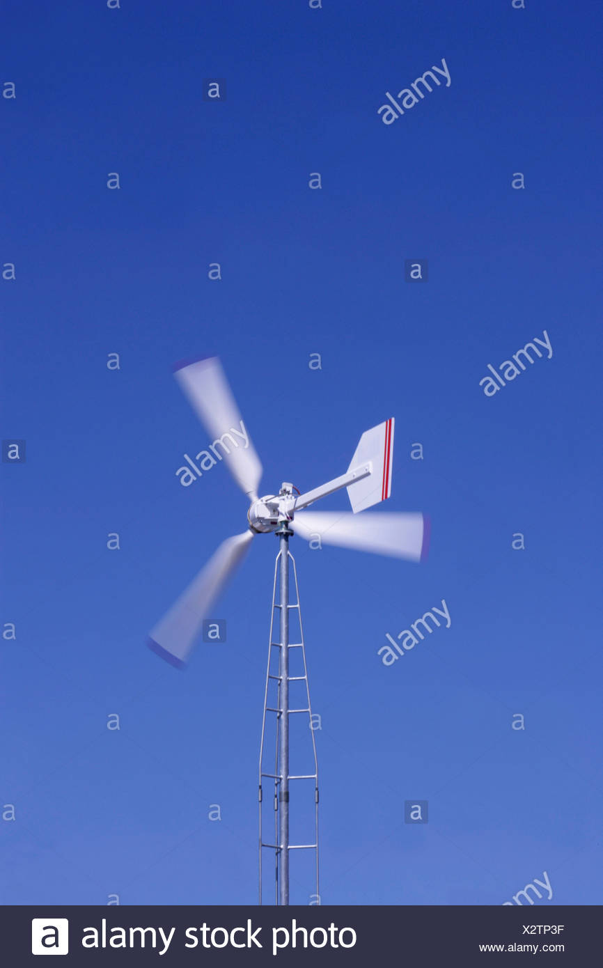 Spinning windmill generates electricity - Stock Image