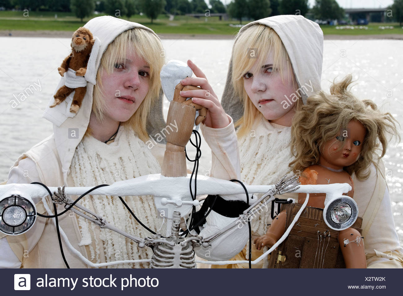 Two Teens In White Robes With Doll And Stuffed Animal Portraying Fantasy Characters Bizarre Costumes White Makeup Cosplayers Stock Photo Alamy