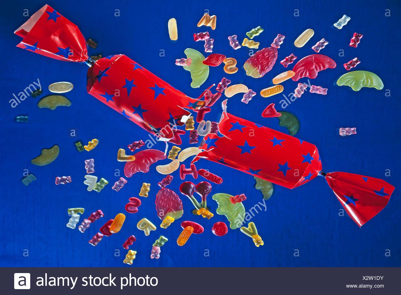 Bursting cracker with fruit gums - Stock Image