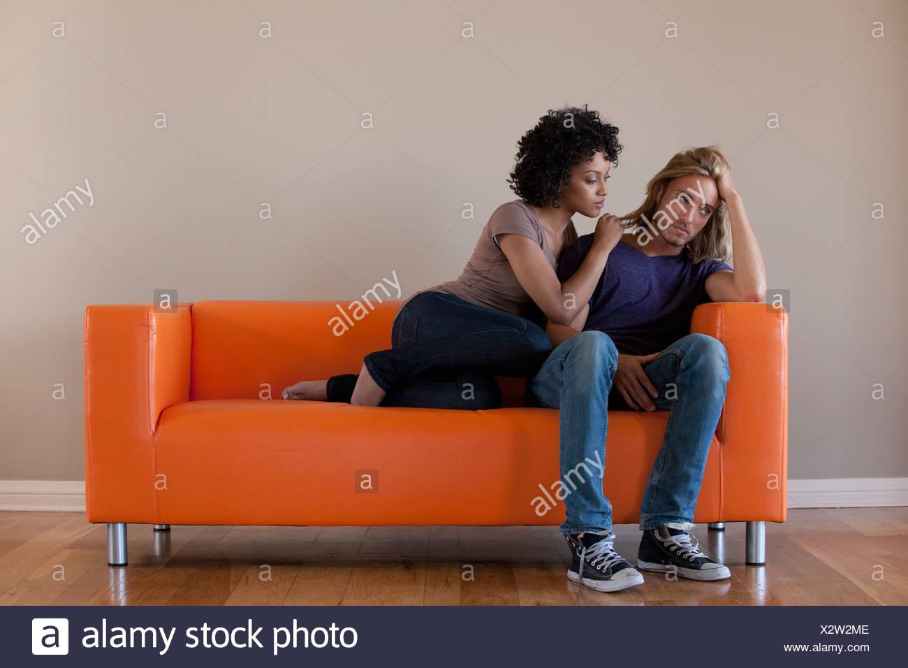 USA, California, Los Angeles, Young couple sitting on sofa - Stock Image