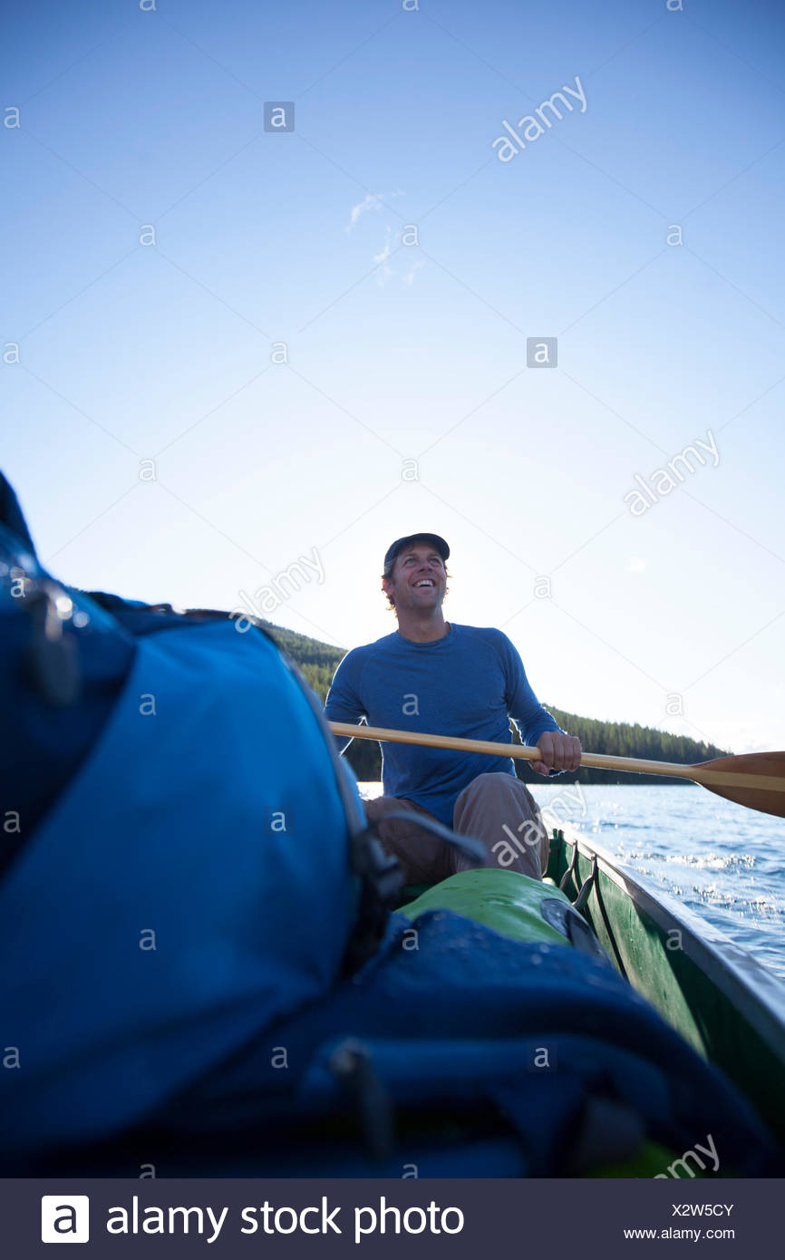 Man in a canoe. - Stock Image