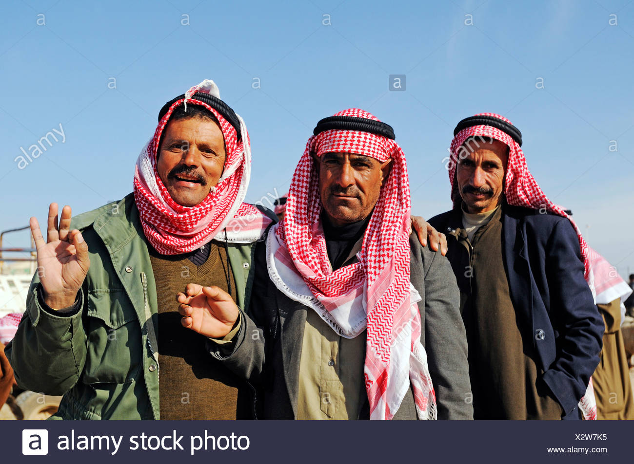 Men on a market for sheep and goats, Kafseh, Syria, Asia Stock Photo