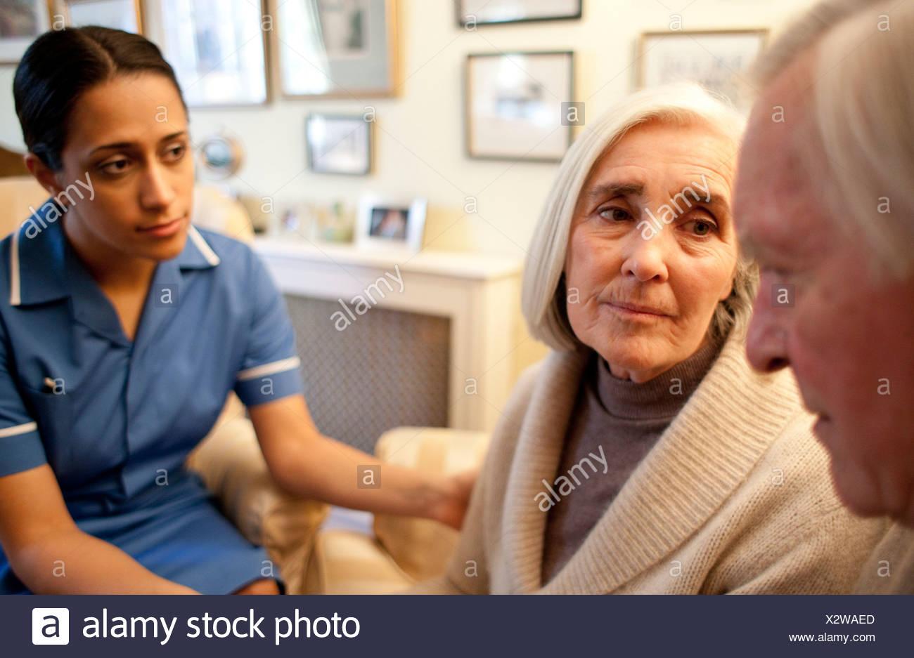 Nurse on a home visit - Stock Image