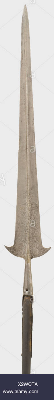 An etched Italian partisan, 16th century. Long double-edged blade with a central ridge on both sides. Parrying hooks on each side at the base of the blade with ornamental etching between monster heads on both sides. Bevelled, tapered socket with two (one broken) languets. Replacement round wooden shaft. Length 219 cm. historic, historical, 16th century, pole weapon, weapons, arms, weapon, arm, fighting device, military, militaria, object, objects, stills, clipping, clippings, cut out, cut-out, cut-outs, metal, Additional-Rights-Clearences-NA - Stock Image