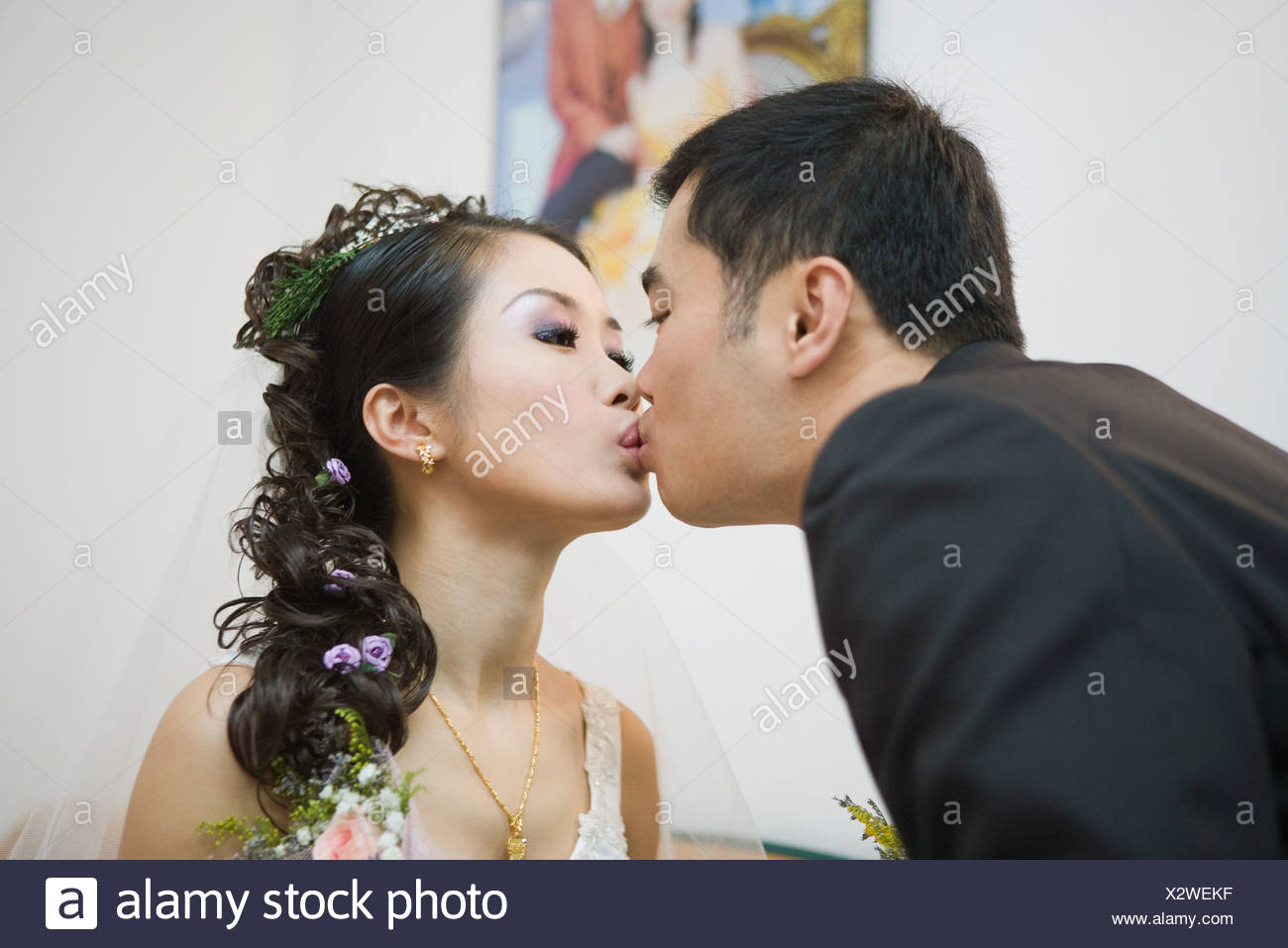 women kissing each other