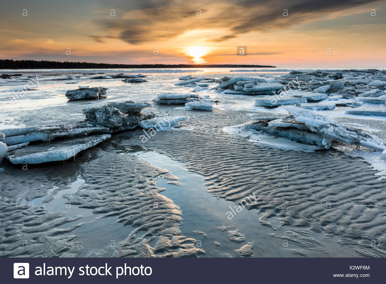 Melting ice on Singing Sands Beach at Dorcas Bay in Bruce Peninsula National Park, Ontario, Canada - Stock Image