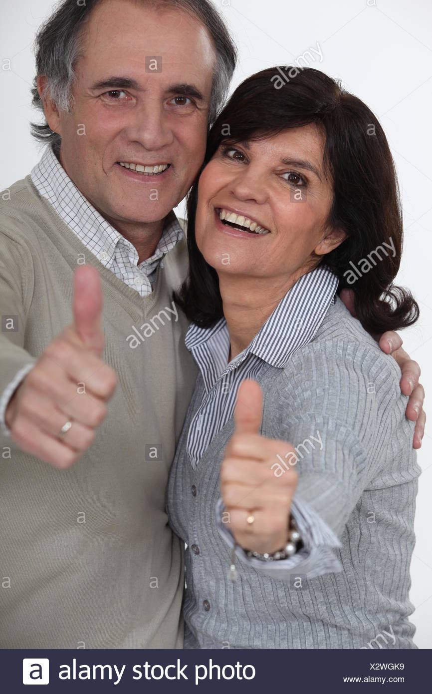 mature couple thumbs up and all smiles stock photo: 277157085 - alamy