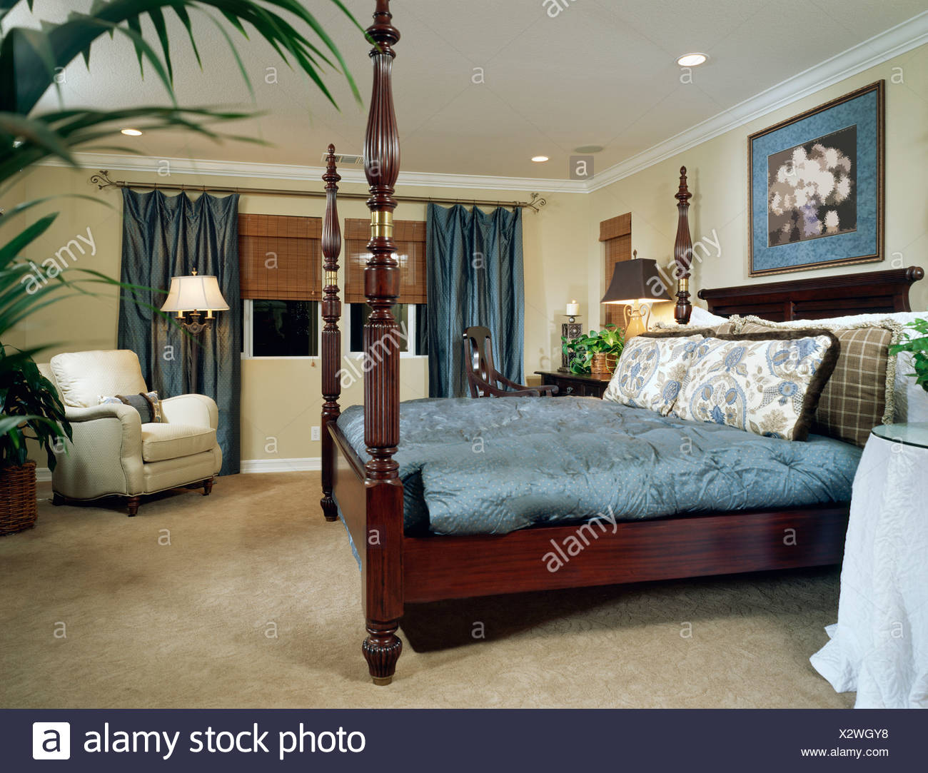 Elegant Bedroom with Four Post Bed - Stock Image