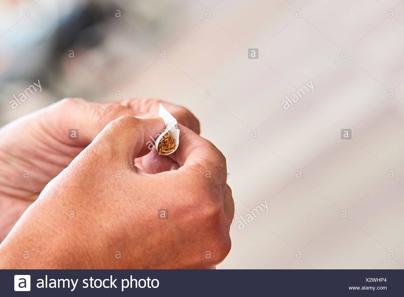 Hand with cigarette - Stock Image