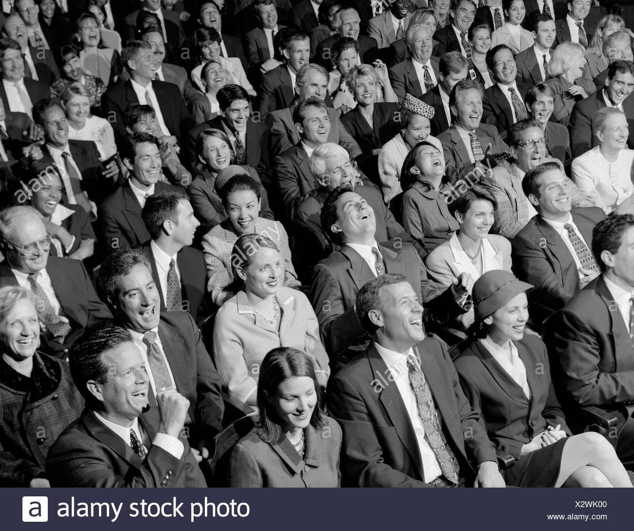 High angle view of audience laughing - Stock Image