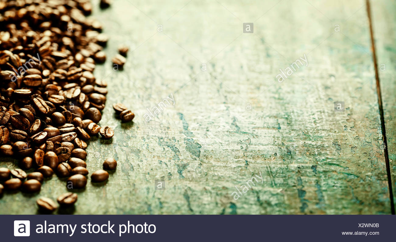 Coffee on grunge wooden background - Stock Image