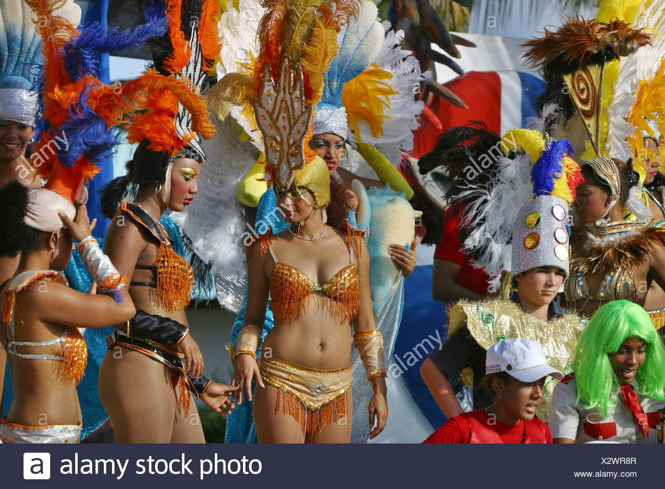 pretty women with feathered headdress on national holiday, Dominican Republic, La Romana, Bayahibe - Stock Image