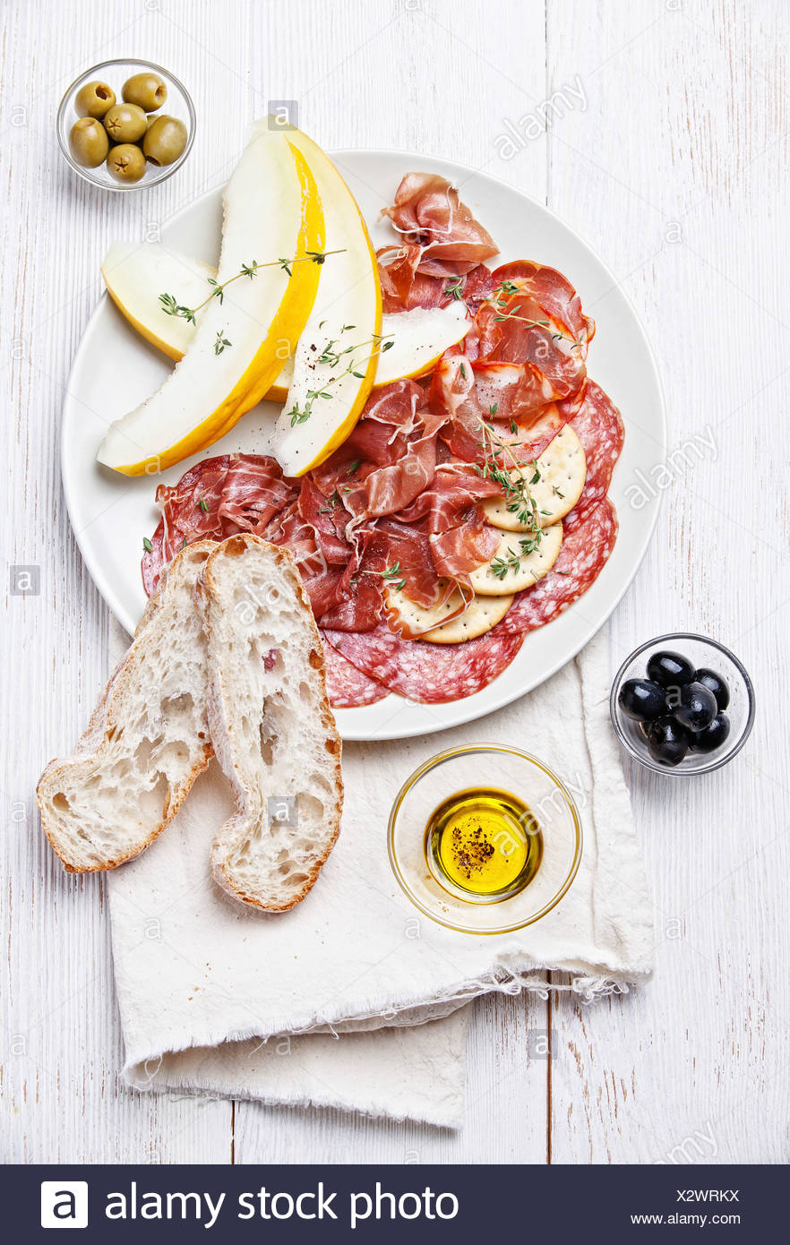 Platter of Assorted Cured Meats and Melon - Stock Image