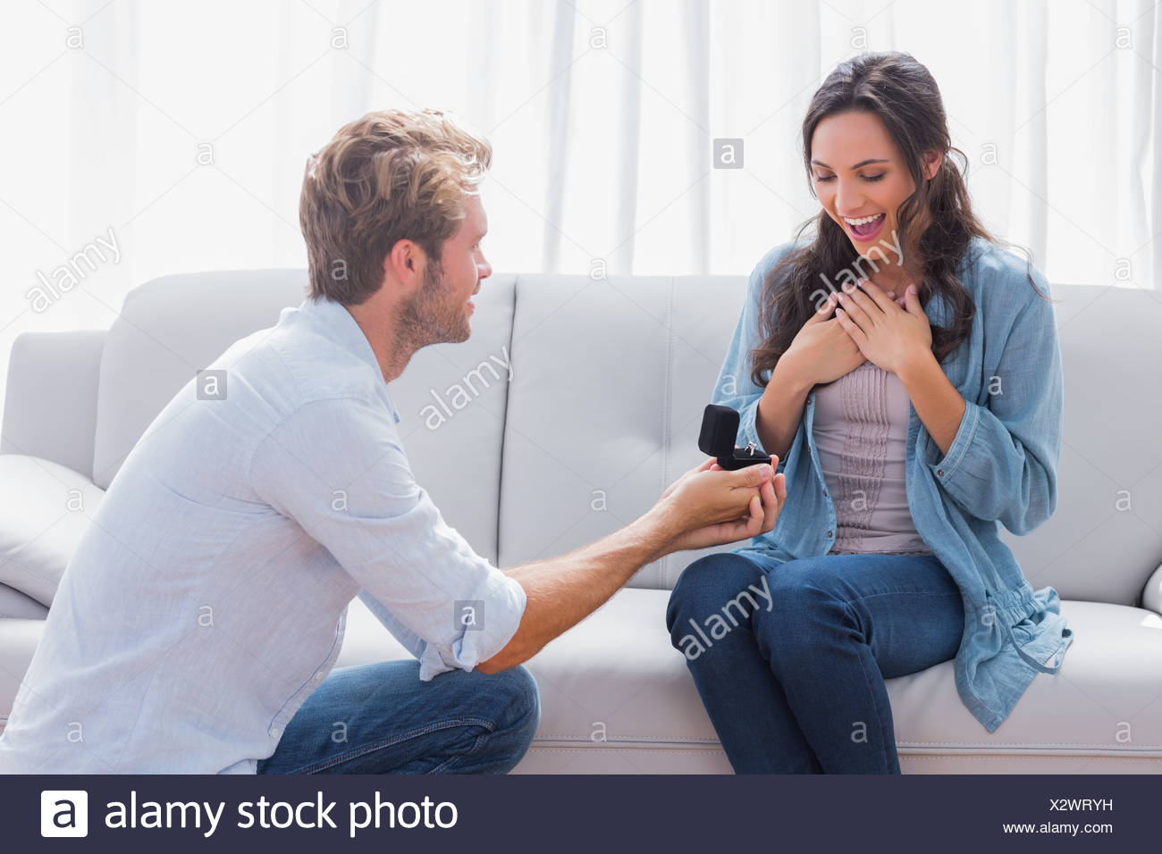 Handsome man doing a marriage proposal Stock Photo