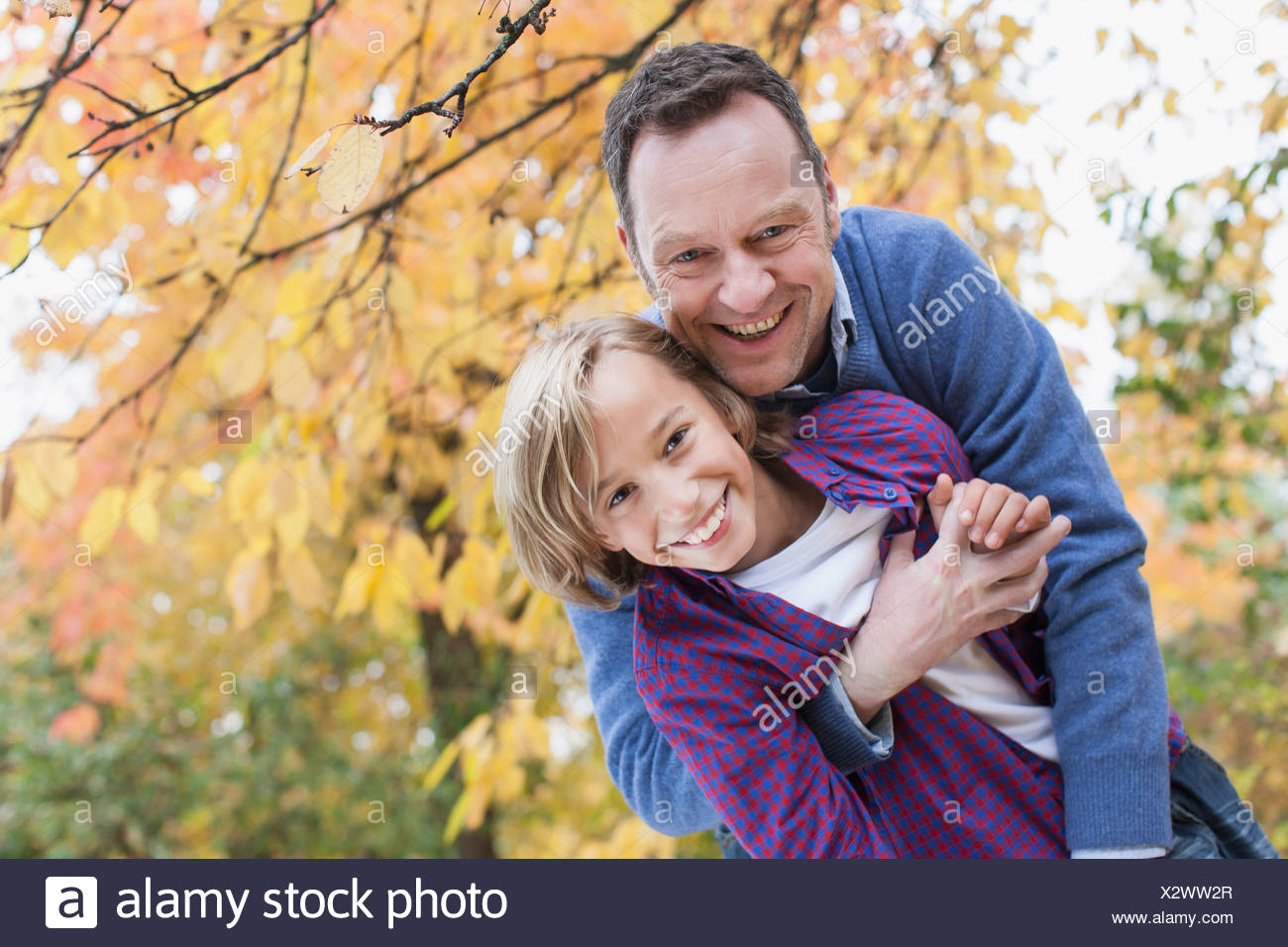 Germany, Leipzig, Father and son having fun, smiling - Stock Image