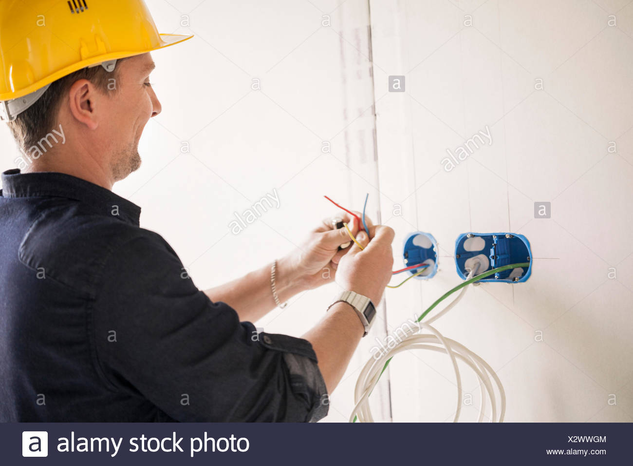 Electrician working at site - Stock Image