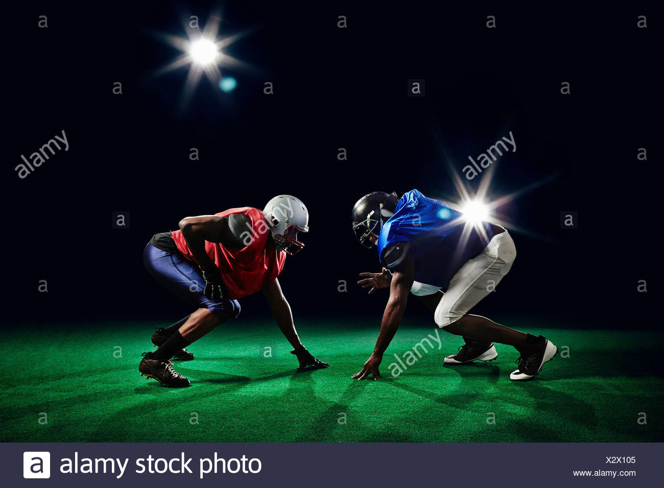 Two american footballers crouching - Stock Image