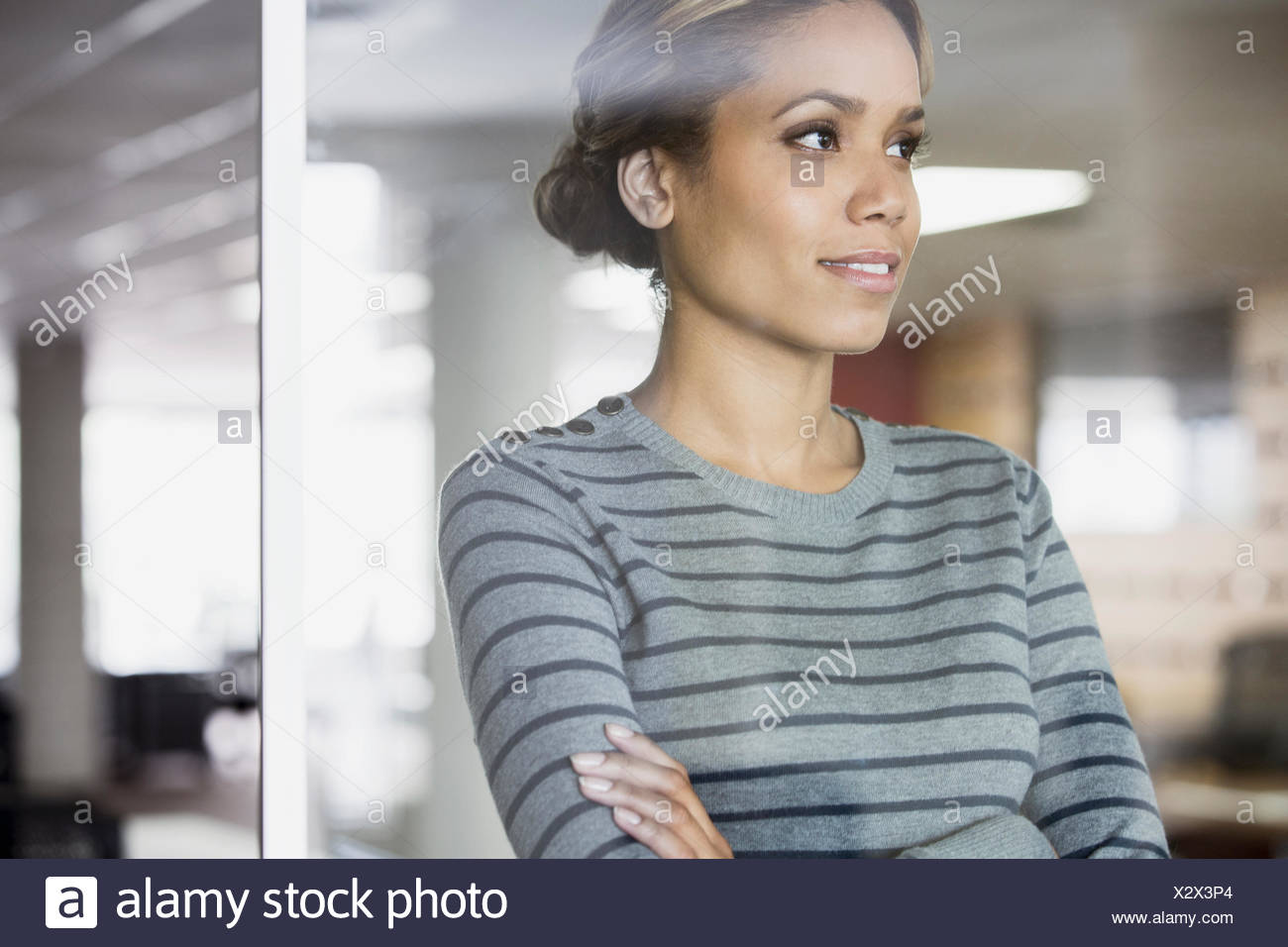 pretty, african american woman in thought at the office - Stock Image