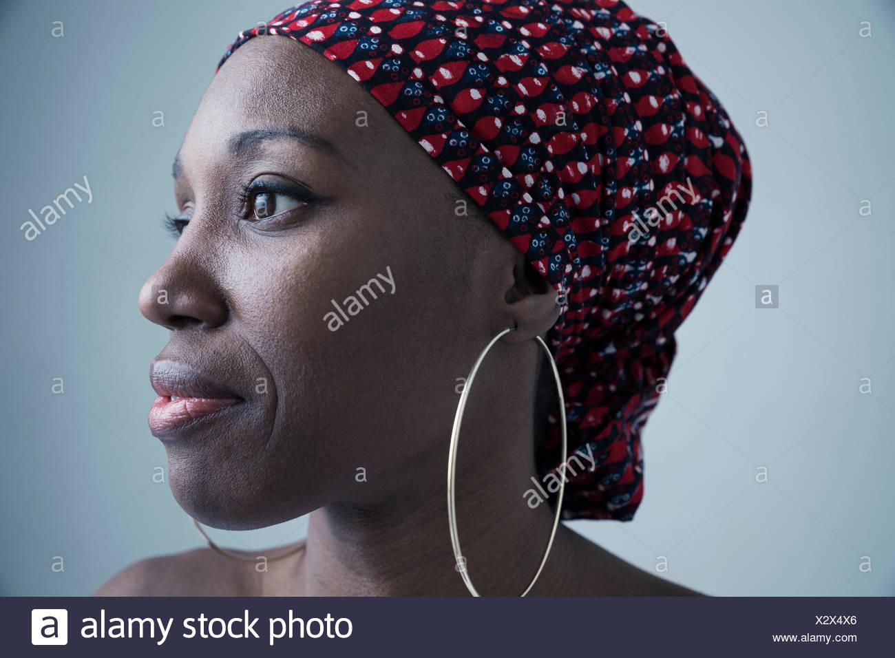 9291e51b35465 Close up portrait pensive African American woman wearing gele ...