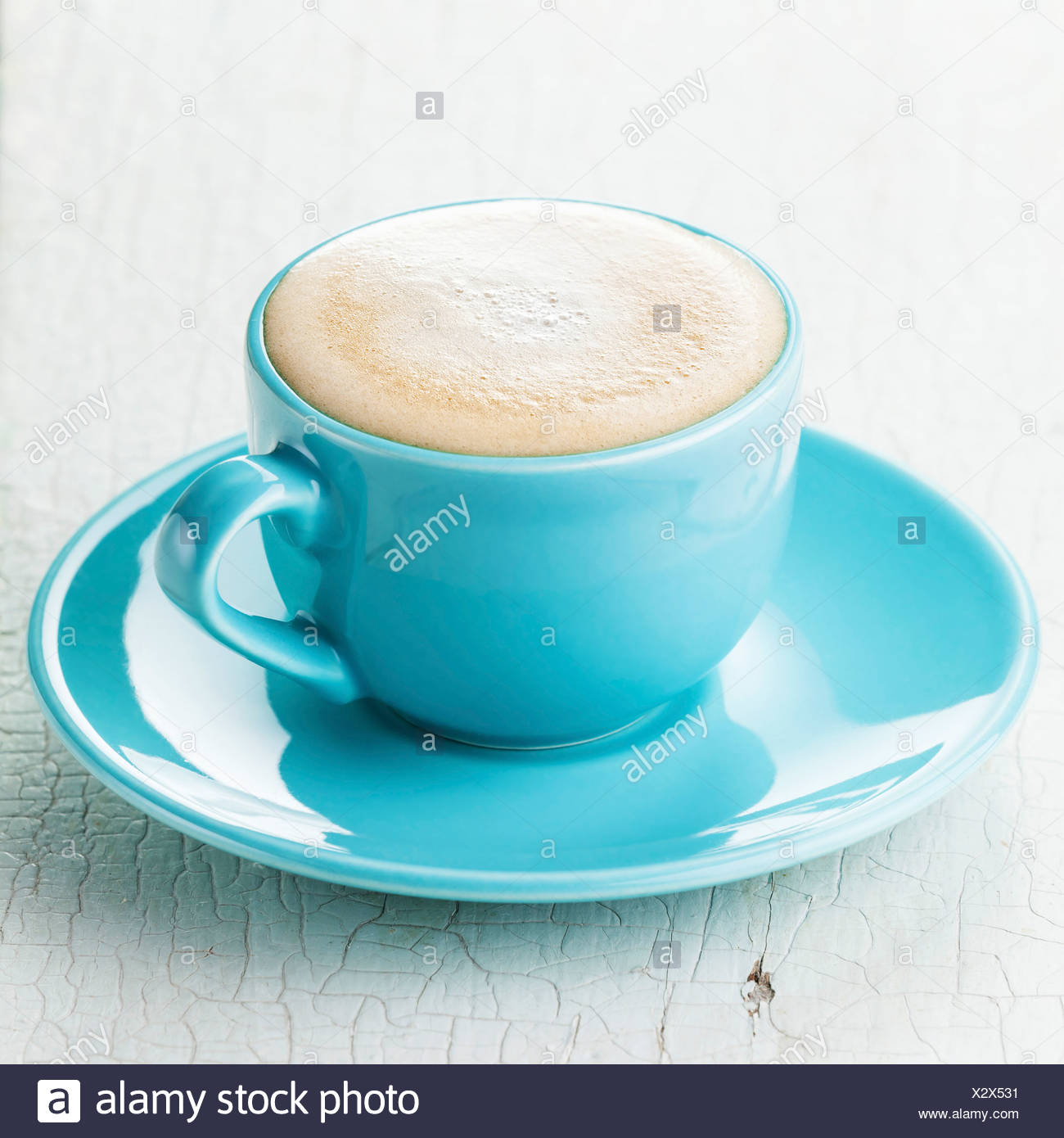 Cappuccino coffee in blue coffee cup - Stock Image