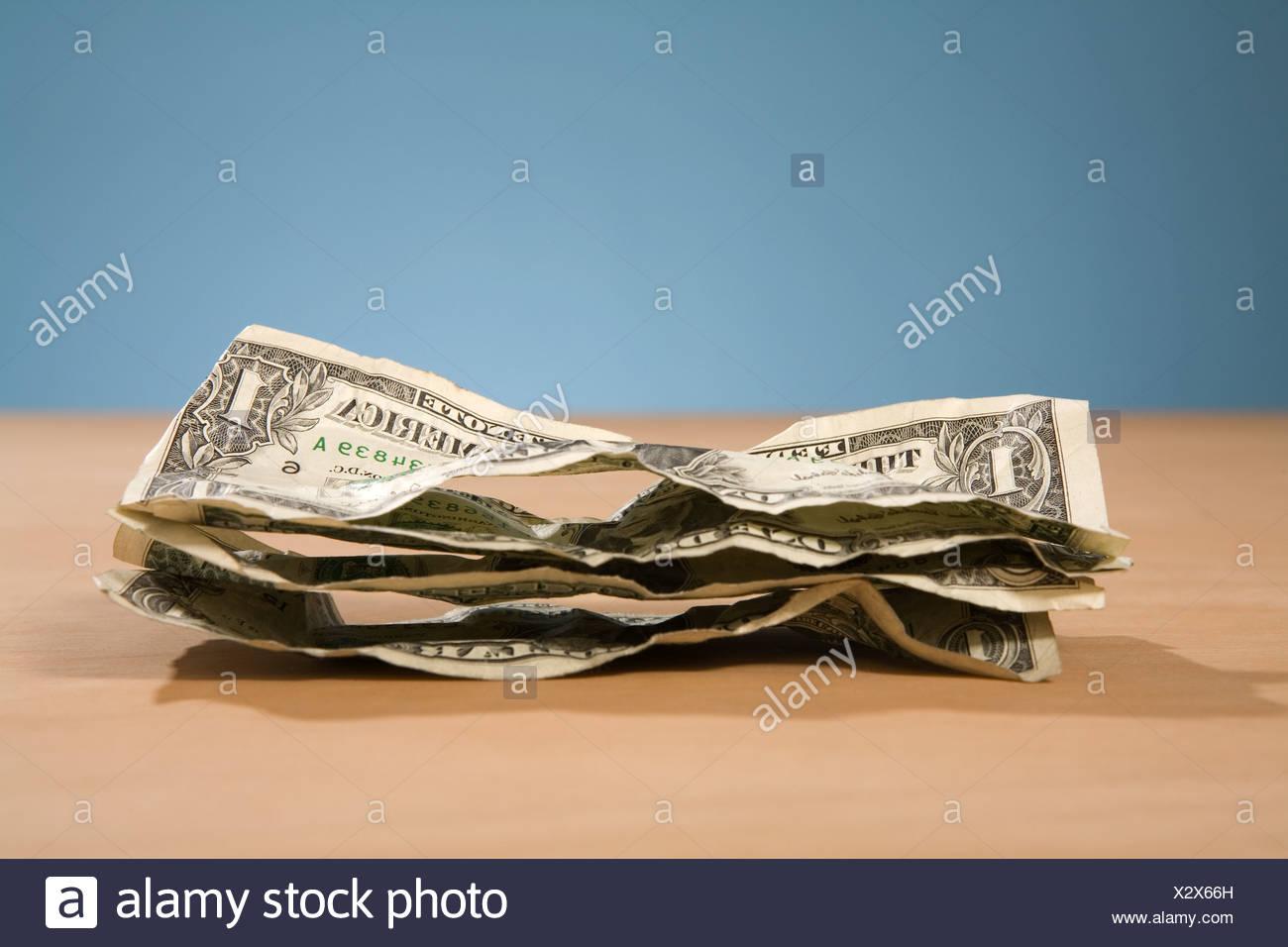 Crumpled Dollar bills - Stock Image