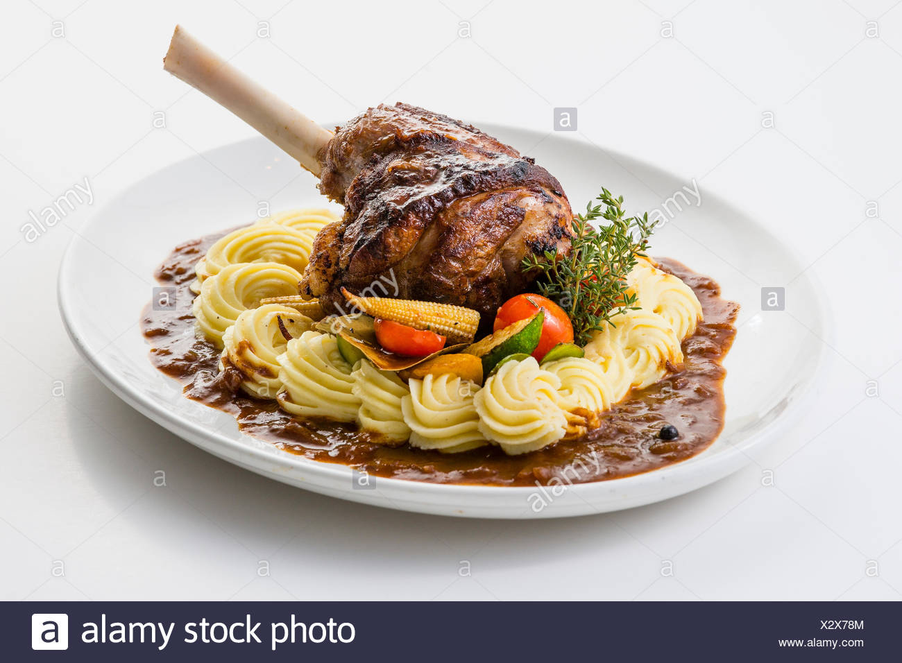 Roasted lamb shank on mashed potatoes - Stock Image