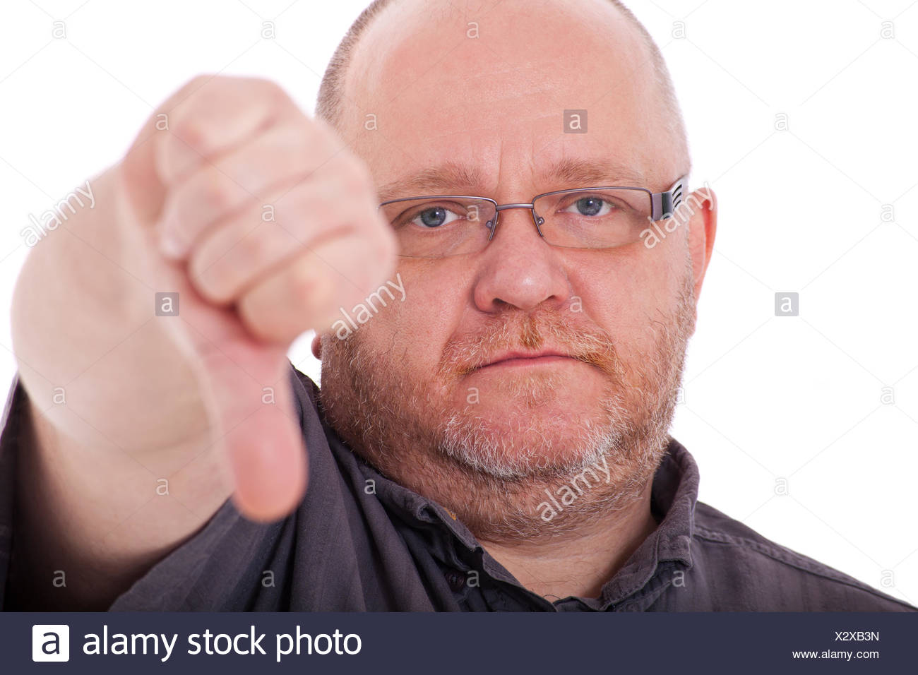 Elderly man showing thumb down - Stock Image