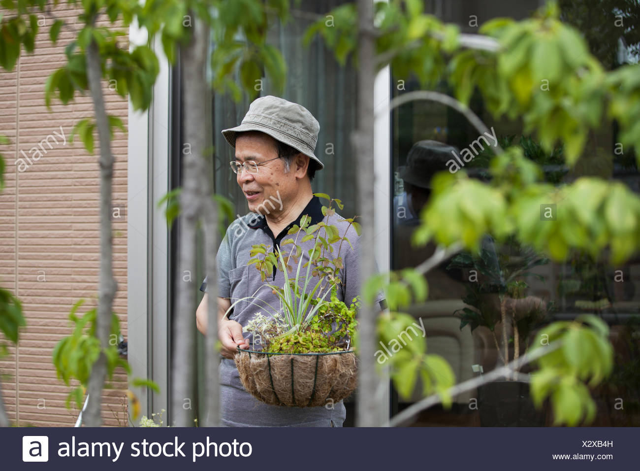 A man standing in his garden. - Stock Image
