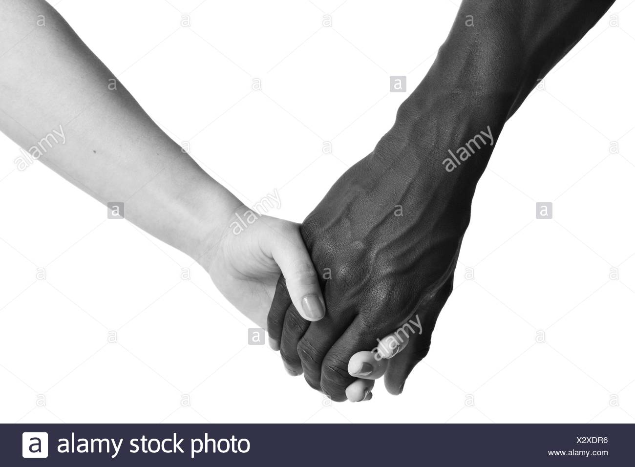 One caucasian and one african hand on white background. - Stock Image