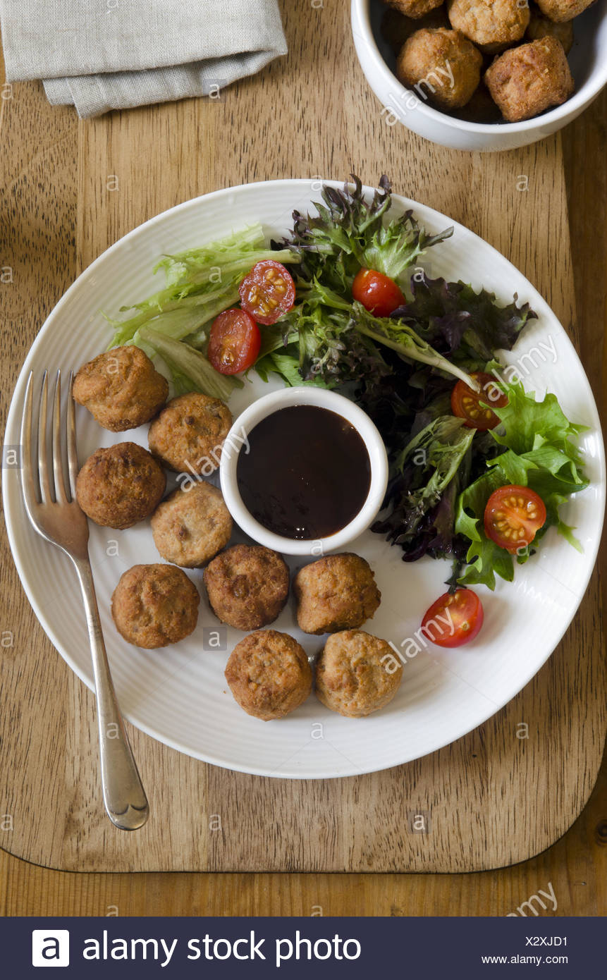 Chicken meatballs with salad and hoisin sauce. - Stock Image
