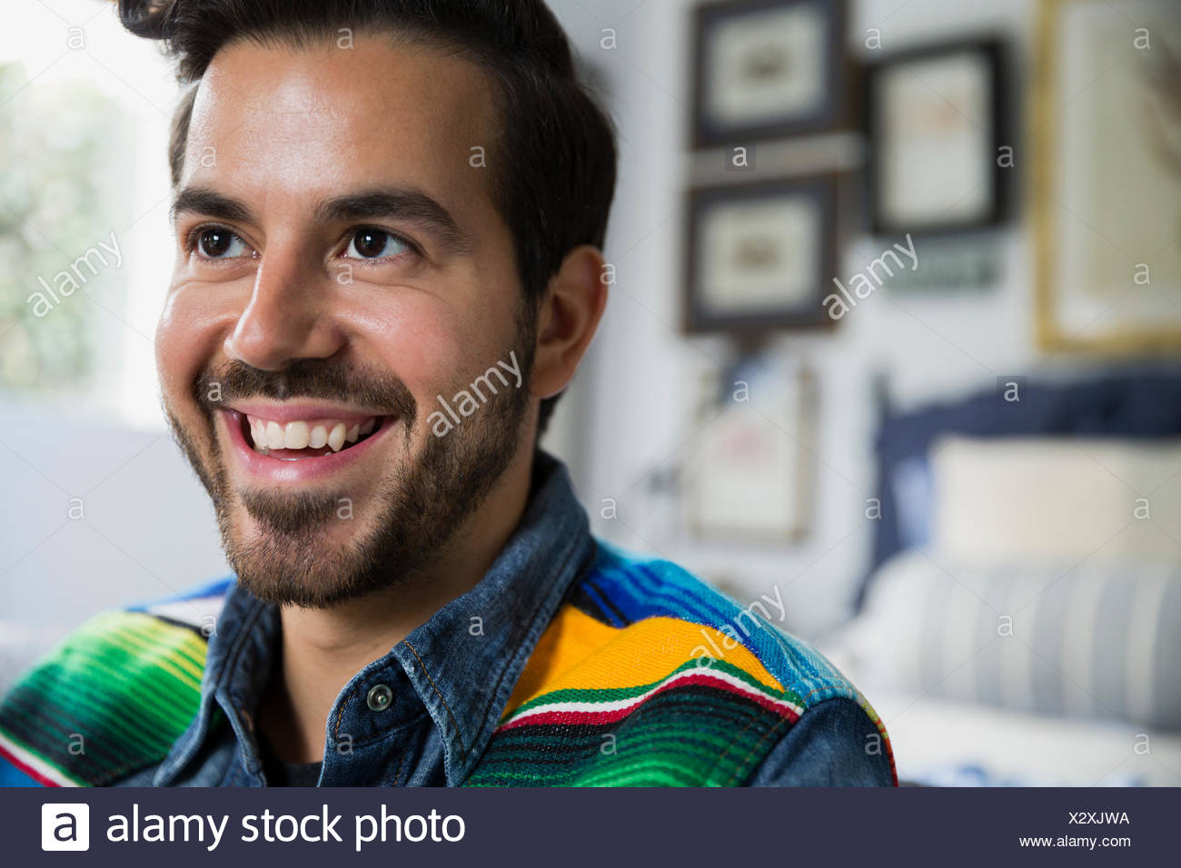 Portrait smiling brunette man looking away - Stock Image