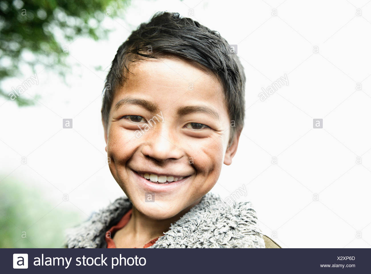 Portrait of a teenage boy smiling, Nepal - Stock Image