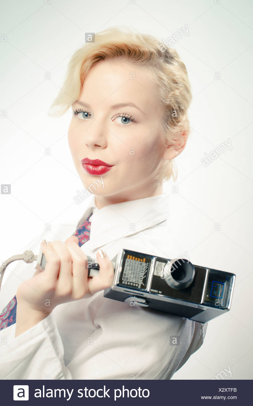 Young Woman Using Video Camera, Portrait - Stock Image