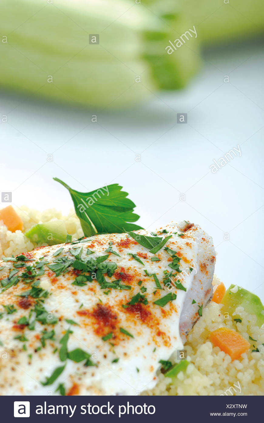 Fish fillets with couscous - Stock Image