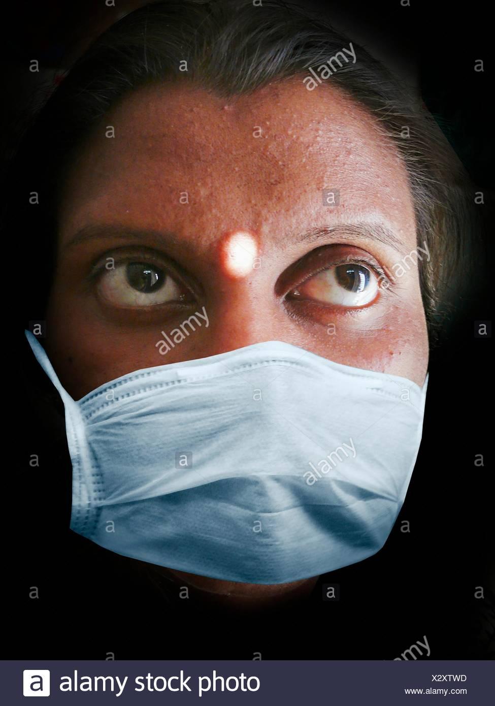 Woman, Precaution mask for Swine Flu, H1N1 Stock Photo