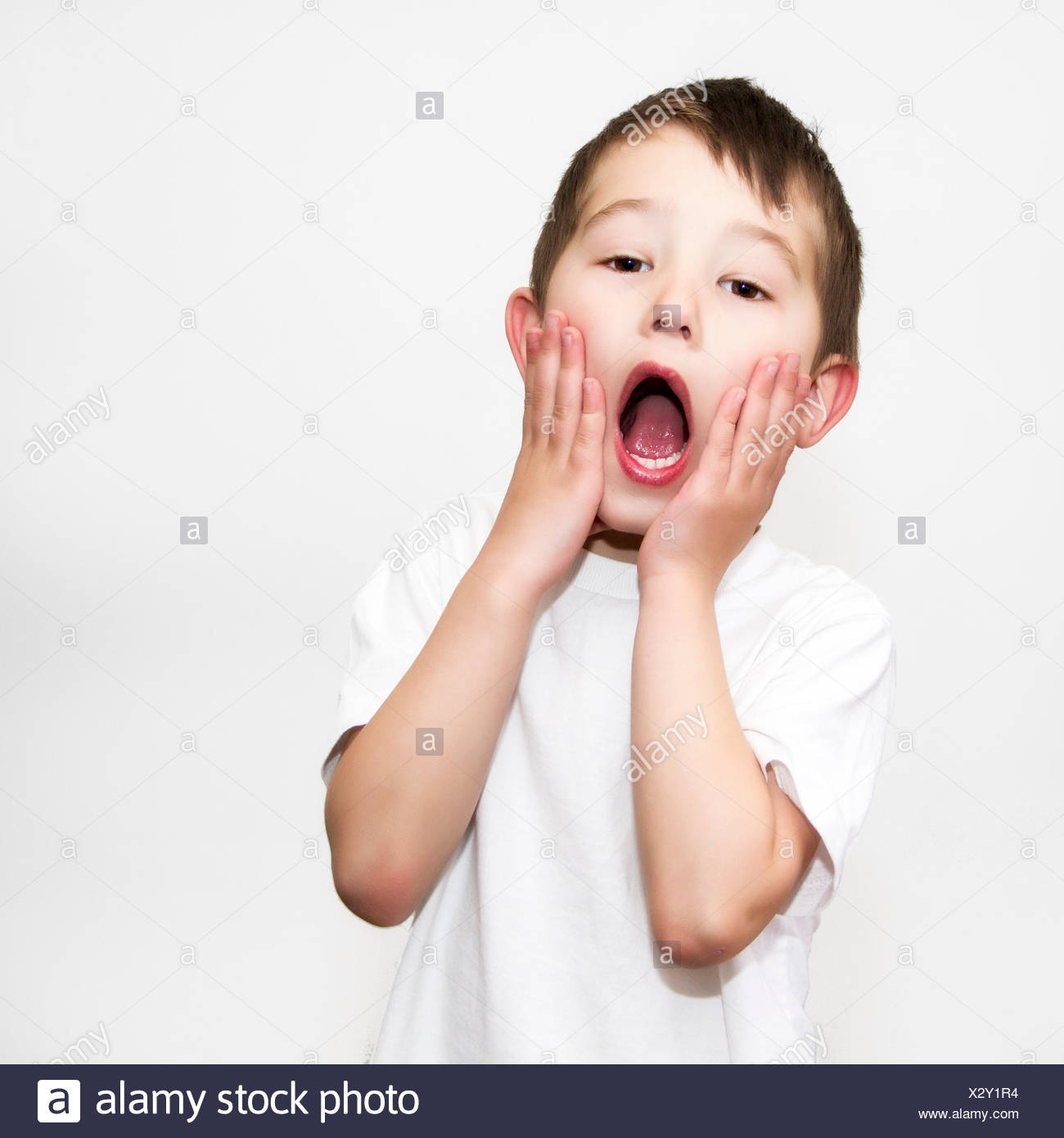 Boy doing home alone pose - Stock Image