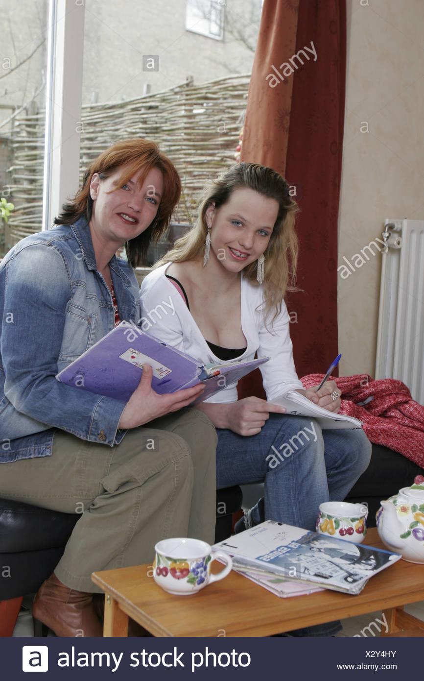 Adult helping teenager with homework - SerieCVS417205 - Stock Image