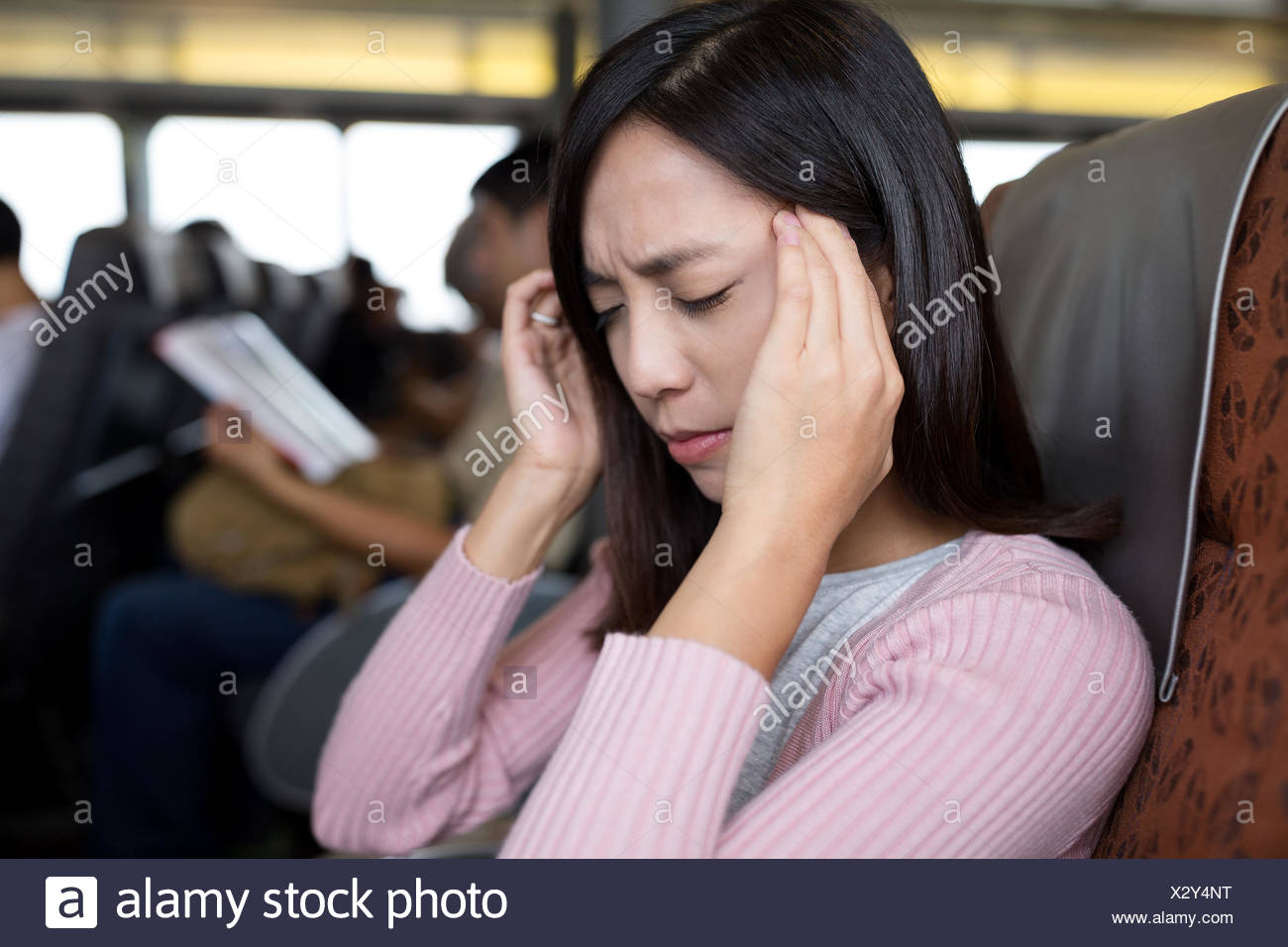 Passenger suffer from headache on the boat - Stock Image