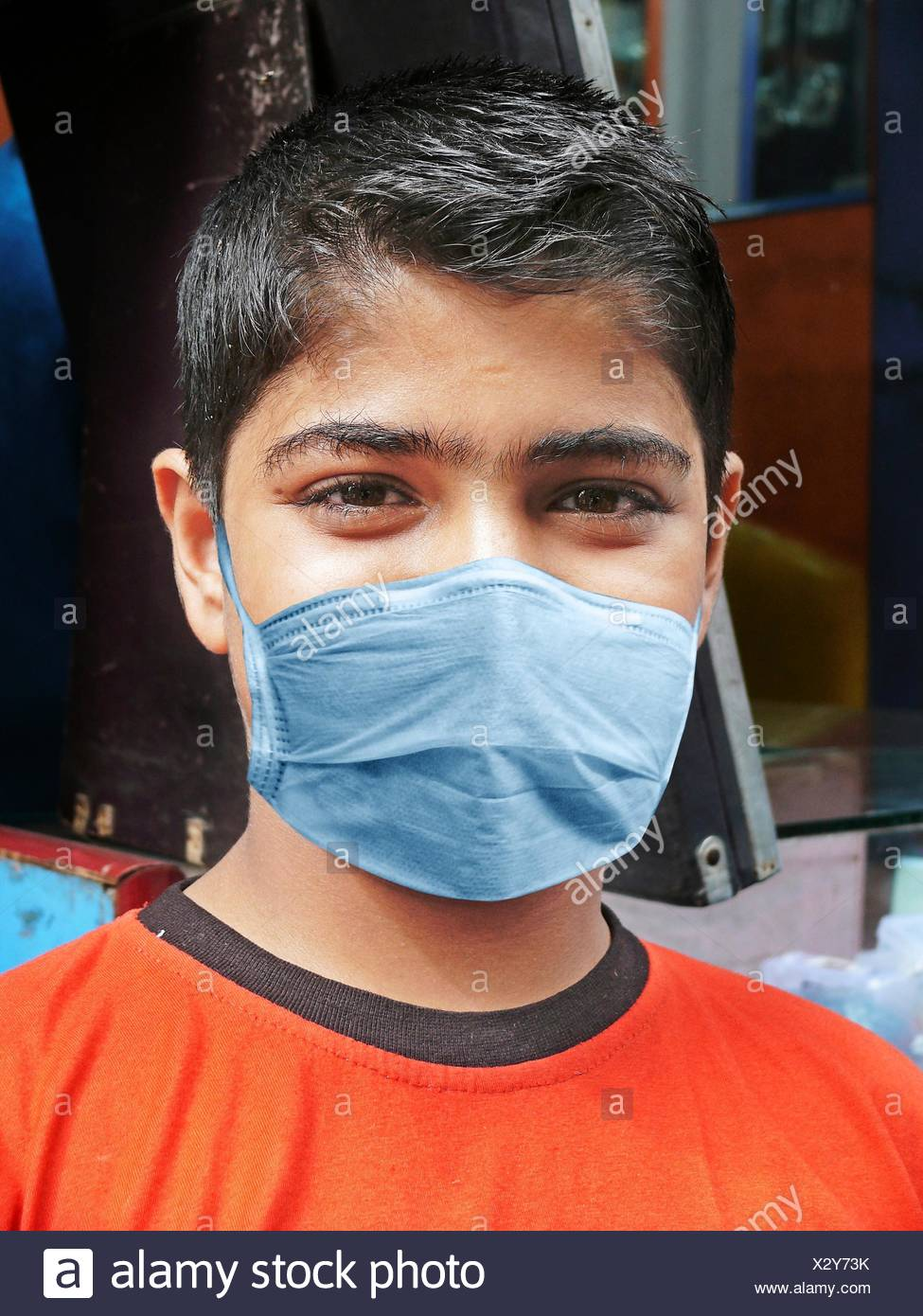 Young boy, Precaution mask for Swine Flu, H1N1 - Stock Image