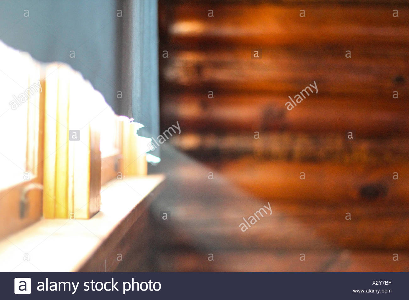 Morning light shines through a window in a cabin - Stock Image