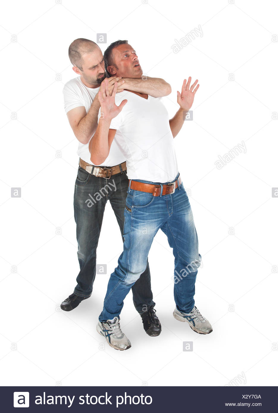 Man attacking from another man - Stock Image