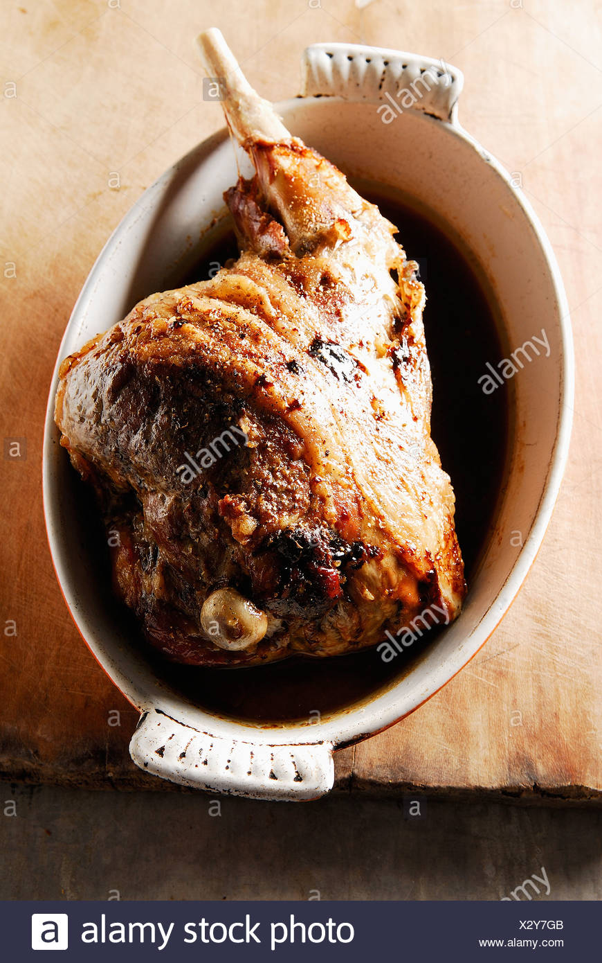 Leg of lamb cooked seven hours in the oven,served with a spoon - Stock Image