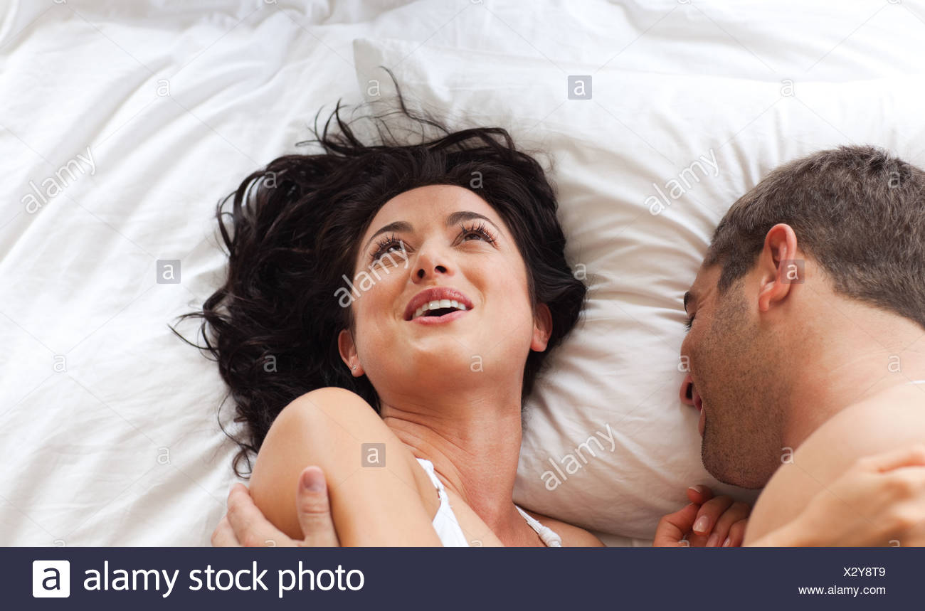 Lovely Couple On A Bed Stock Image