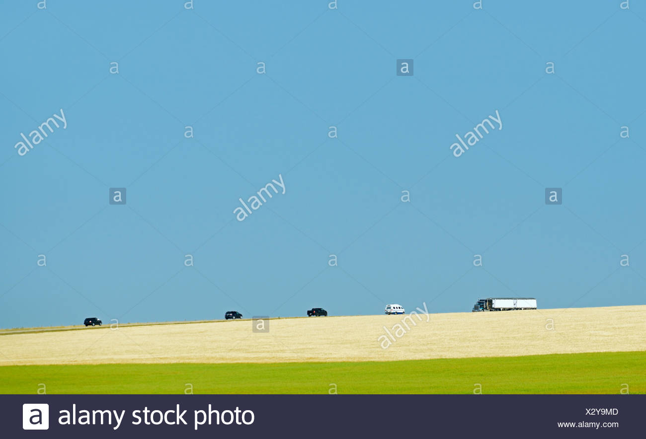 Vehicles on Highway 24 Mossleigh Alberta Canada - Stock Image