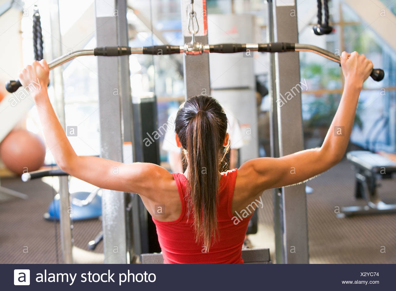 Woman Weight Training At Gym - Stock Image