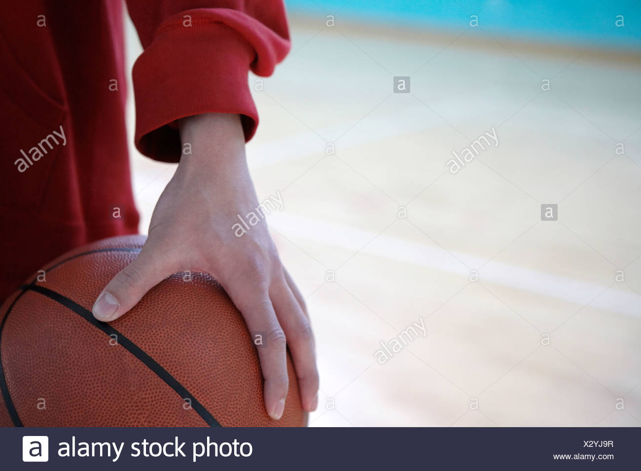 Person Holding A Basketball - Stock Image
