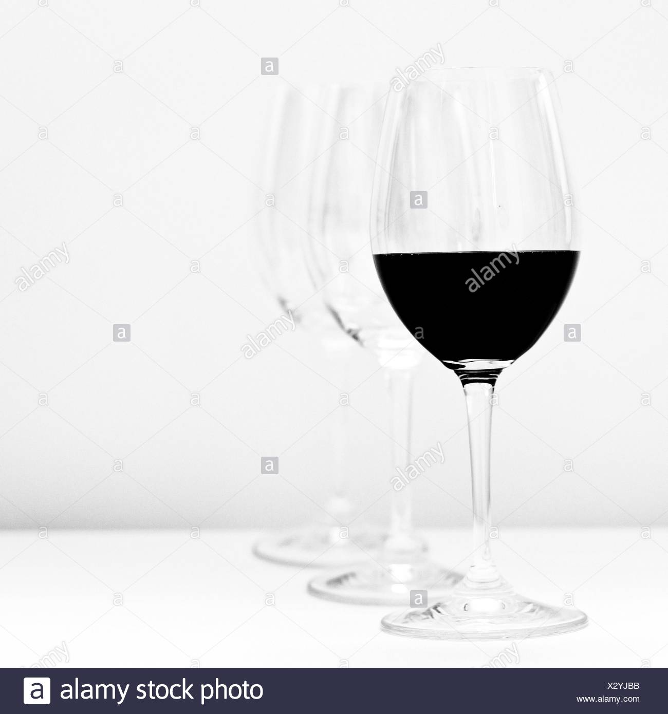 Wine Served On Table Against White Background - Stock Image