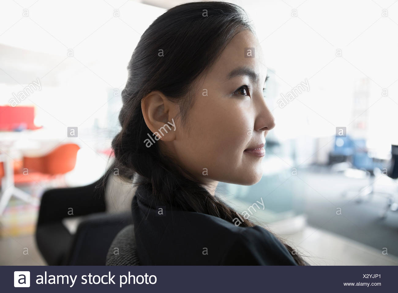 Close up profile serious, pensive businesswoman looking away Stock Photo
