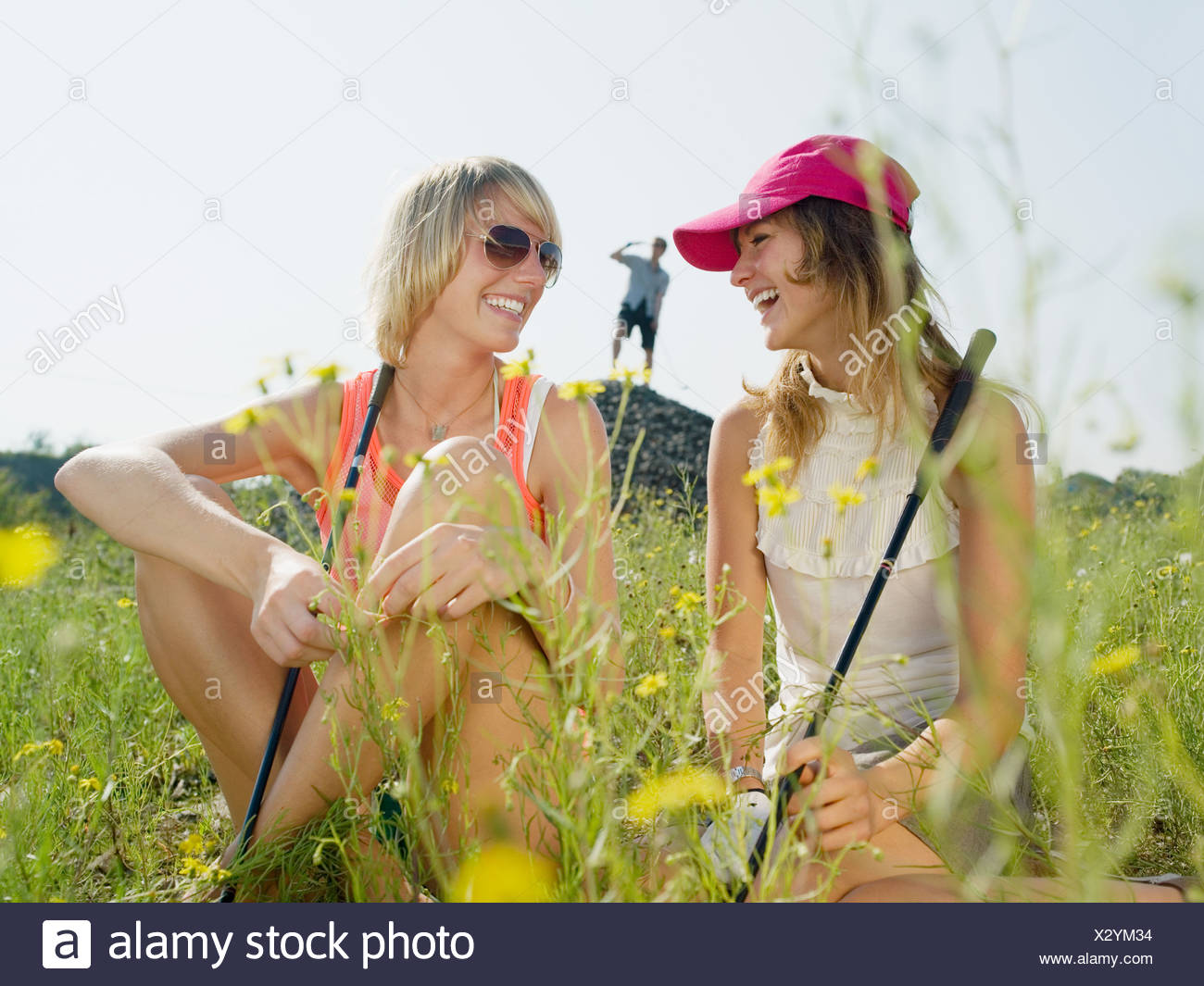 Young female golfers laughing Stock Photo