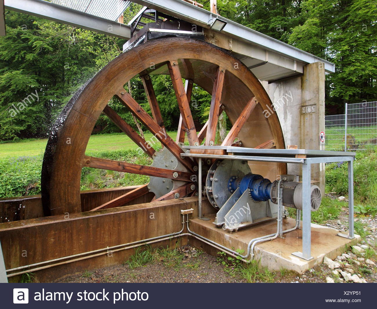 modern water wheel to generate electricity stock photo 277205293